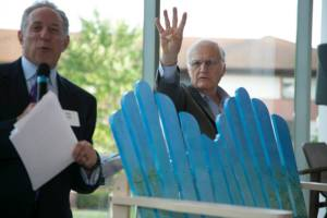 "John Joseph and Mark Milligan auction off Amy Webber's bench, ""Sea Breeze"""